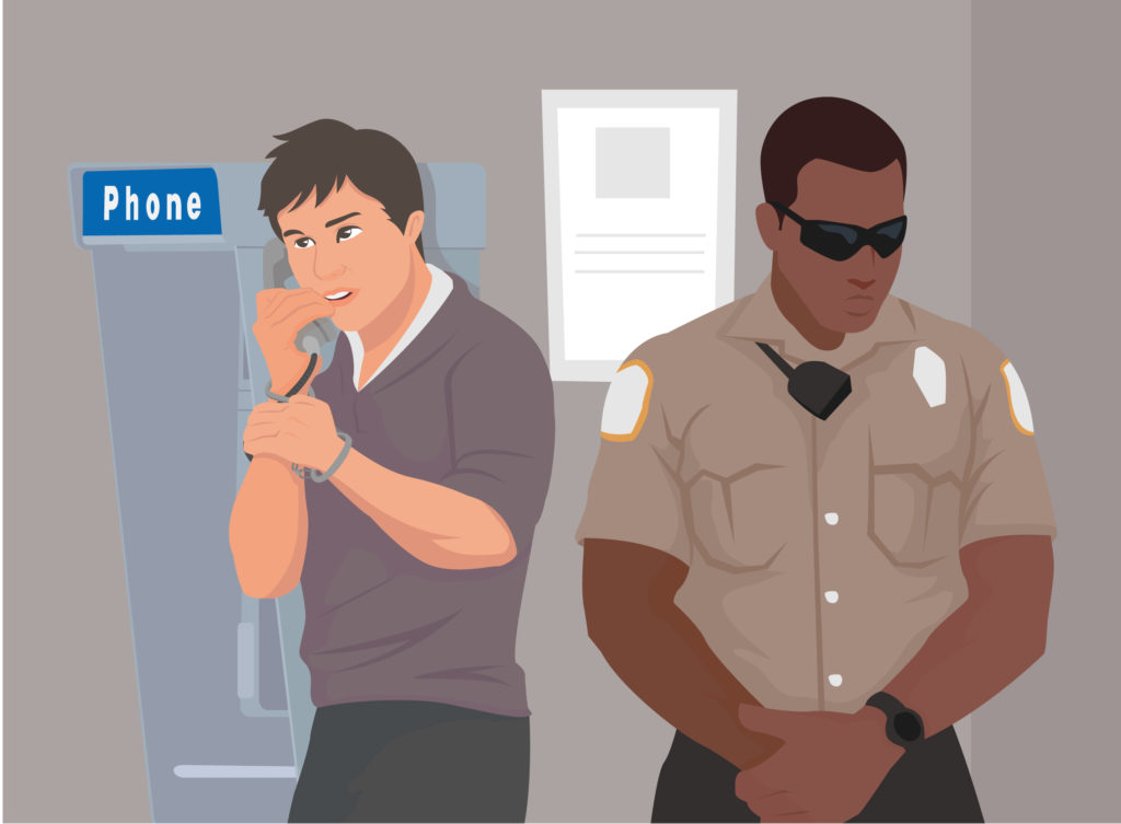 graphic of an inmate using the payphone
