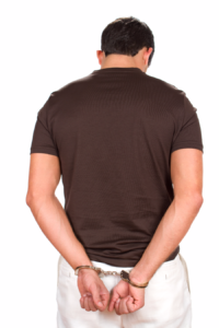 back view of a handcuffed man
