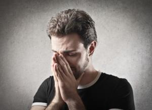 Depressed man praying