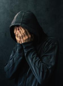 desperate man in hooded jacket