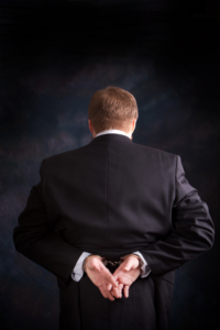 Handcuffed man in suit