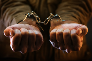 handcuffed man with clenched fists