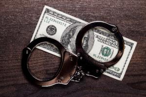 hundred dollar bill and handcuffs
