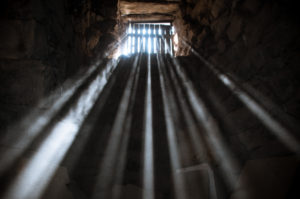 sunlight beaming through jail cell window