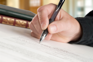 right hand signing a contract