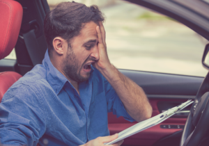 shocked male driver reading a document
