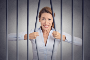 woman bending jail bars